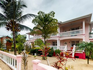 Two resort suites with shared pool access, balcony beach views & prime location