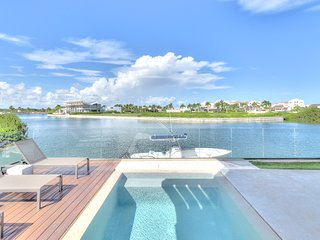Modern Seaside Villa at Cap Cana Marina with Boat and Captain included