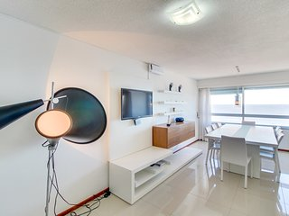 Elegant high-rise condo with ocean view & shared indoor pool/gym - near beach!
