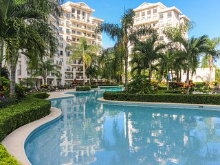 Stylish condo w/ balcony & shared pool - steps to the beach, small dogs OK!