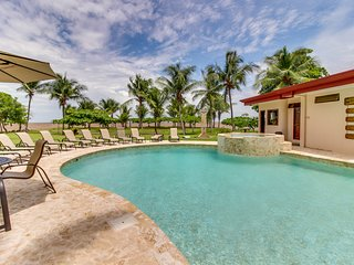 Relaxing retreat in oceanfront resort with shared pool and peek-a-boo sea views