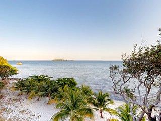 NEW LISTING! Beachfront resort suite w/deck, hammock, kayaks & incredible views