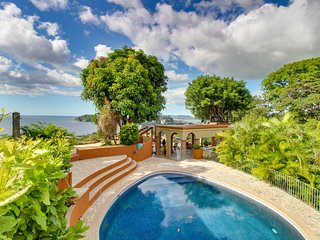 Hilltop villa & 3 guesthouses w/ pool, decks & amazing ocean view - near beach!
