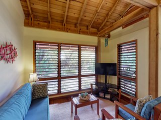 Breezy villa with shared pool, dock, kayaks, and nearby beach access