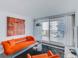Modern condo with terrace & shared indoor/outdoor pools, gym & sauna!
