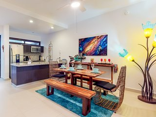 Ground-level condo w/ full kitchen, furnished patio, & shared pools - near beach