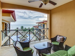 Lovely oceanfront condo with shared pool moments away from beach!