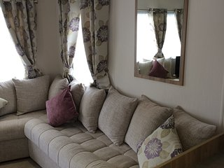 3 bed luxury caravan with private parking and decking.