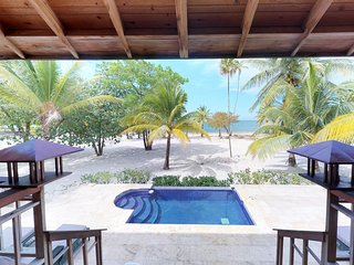 Oceanfront villa with private & shared pools, immediate beach access