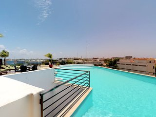 NEW LISTING! Modern city-view condo w/shared pool, community rooftop deck
