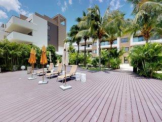 NEW LISTING! Sleek, modern condo w/ shared pool - near beach and golf