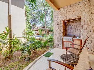 Condo with shared pool, patio & jungle landscaping - walk to the beach!