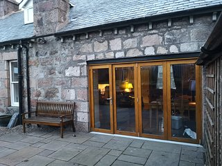 View from the patio area.  Bifold doors open for al fresco dining. Fully enclosed garden and patio.