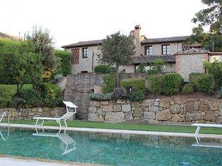 Appartamento L'OLIVETA con giardino privato e piscina