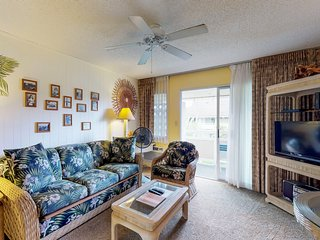 Breezy condo with shared pool, hot tub, short distance away from the beach