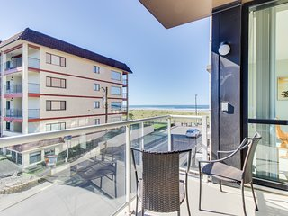 Beautiful contemporary condo w/ ocean views, shared pool, & sauna at Sand & Sea!