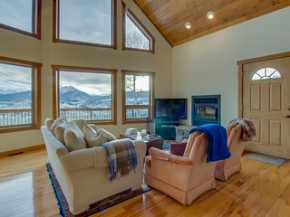 Rugged luxury awaits at this lovely house with stunning mountain & lake views