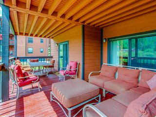 Mountain condo w/ huge patio, forest views & shared hot tub/pool