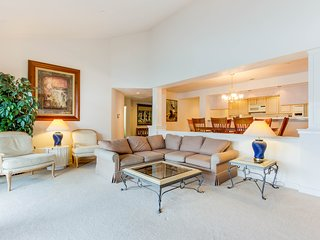 Lakefront condo with calming views, large balcony & shared pool/marina!