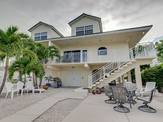 Breezy waterfront home w/shared pool, 35-ft dock, access to Cabana Club!