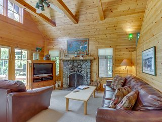 Charming, waterfront cabin near the river w/ cozy fireplace, deck, & grill
