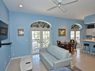 Sunny condo w/ entertainment, balcony, & great location near the beach! Dogs OK!