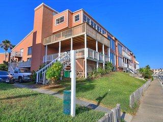Dog-friendly condo with two shared pools, fitness center, & boat slips