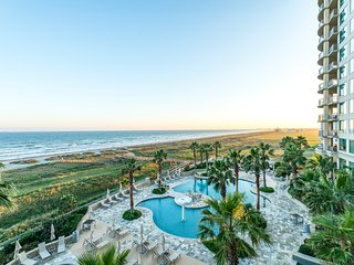 Upscale oceanfront condo features shared pool, hot tub, sauna, and nearby beach!