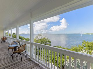 Elegant, waterfront home w/ private pool and covered deck with ocean views