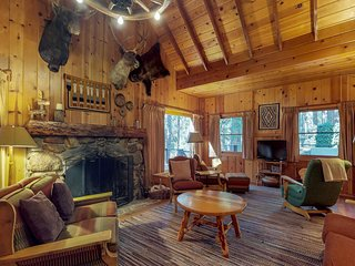 Beautiful lodge with two porches, wood-burning fireplace, & all-wood interior
