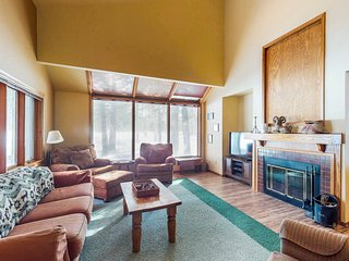 Dog-friendly condo with shared pool, balcony, fireplace, and golf course view