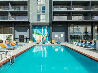 High-rise studio condos w/ shared pool, gym & outdoor rooftop lounge - views!