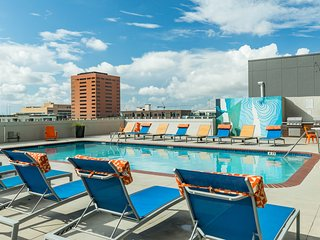 NEW LISTING! High-rise apartment w/ shared pool in the heart of downtown