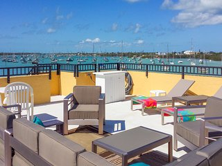 Three-condo waterfront villa w/ four boat slips & roof deck!