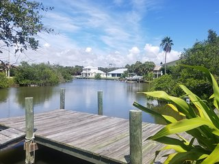 Riverfront home w/dock, 2 kayaks & shared pool/tennis-walk to beach