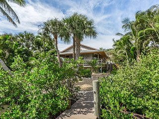 NEW LISTING! Unique waterfront home nestled in the palms w/private hot tub