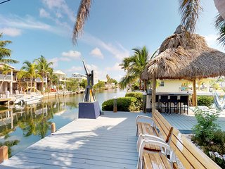 NEW LISTING! Waterfront home on canal with Tiki hut and amazing water views!