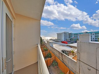 Bright, oceanfront condo w/shared pool, ocean views & beach access!