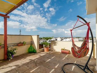Modern apartment w/ terrace, city views, and easy access to the beach!