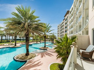 Waterfront condo w/ shared pools, hot tub, lazy river, & gym - steps to beach