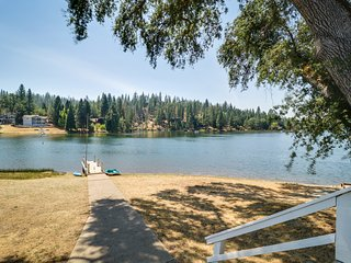 NEW LISTING! Historic, waterfront home with a shared pool, tennis, and lake view
