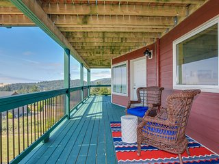 NEW LISTING! Bright & open hillside home with sprawling ocean views!