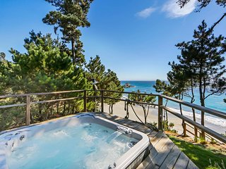 Waterfront home with private hot tub, patio, and beach access!