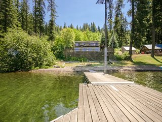 NEW LISTING! Lakefront home w/private dock, deck & stunning lake/mountain view