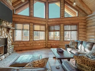 NEW LISTING! Luxury log home & carriage house w/fireplace & deck.