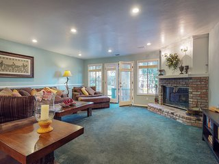 NEW LISTING! Golf course view home w/ wood burning fireplace,
