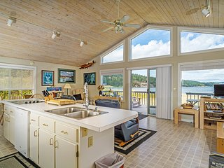 Modern waterfront home moments from shopping, dining, & beaches!