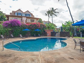 NEW LISTING! Beautiful 2-story condo w/lanai, shared pool & more - walk to beach