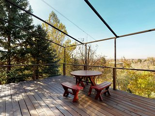 NEW LISTING! Mid-century home w/ a gas fireplace & large deck w/ beautiful views
