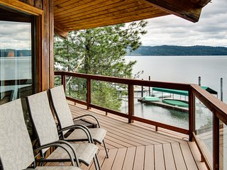 Unique home w/ stunning lakefront views, a wrap-around deck & a private dock!